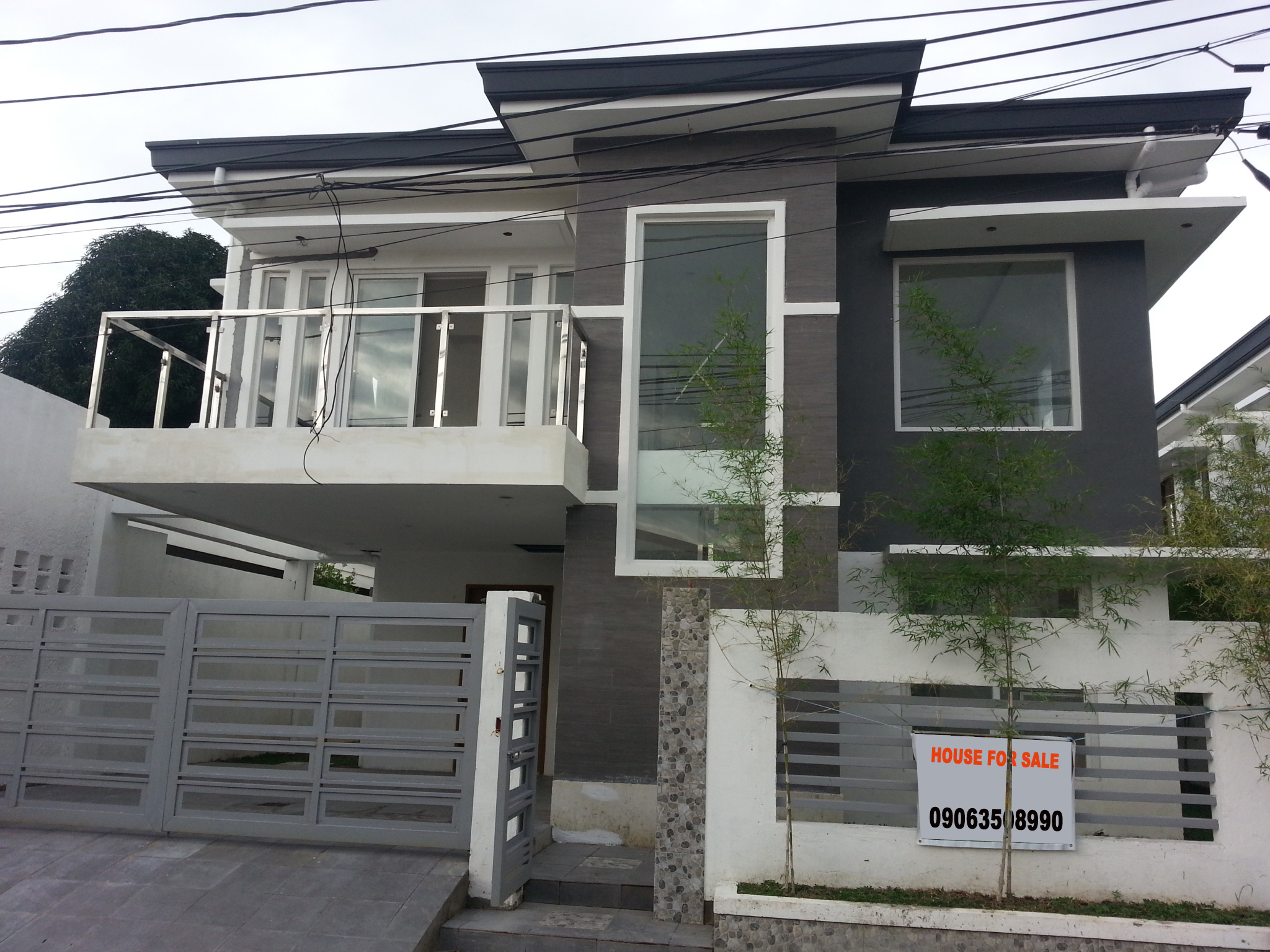 Good looking 2 storey house and lot for sale sui realty for Best looking houses